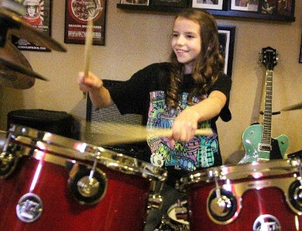 """Ashlyn Price, 11, is competing in the Hit Like a Girl drumming contest. The Bright's Grove girl's video submission shows her drumming to """"The Spirit of Radio"""" by Rush. (Tyler Kula/Sarnia Observer)"""