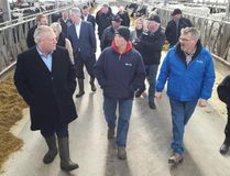 Ontario Progressive Conservative leader Doug Ford, left, speaks with Josh Ireland, centre, and Mark Irleand, right, while on a tour of their dairy farm, Albadon Farms, near Teeswater, Ont. on Thursday, April 19, 2018. Ford stopped at Bruce Power earlier and went on to a PC rally in Mildmay Thursday evening. Rob Gowan/The Sun Times