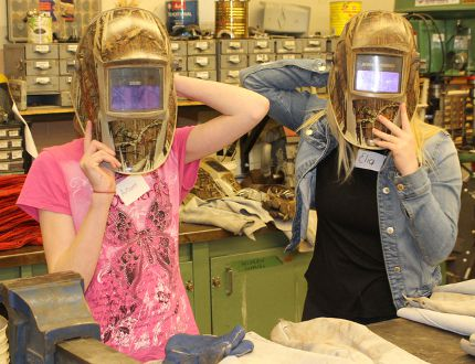 Kincardine District Secondary School reached out to female students and local women interested in finding out the options of a trades-based education and trades-based career choices during the Women's Tech Promo Event at the KDSS on April 11, 2018. Pictured: Autumn Blake and Elia Schausbreitner try on some of the safety equipment required when doing a welding job during the KDSS Female Student Night Out Event on April 11, 2018. (Ryan Berry/ Kincardine News and Lucknow Sentinel)