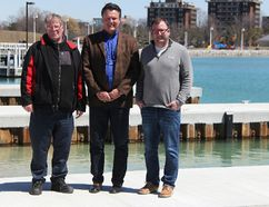The Bluewater Anglers' Ed Holubowicz, left, Bridgeview Marina's Dave Brown, and John Cowan of Needham's Marine, check out the nearly completed municipal boat launch on Sarnia Bay Friday. The City of Sarnia announced Friday the launch will be open to the public April 26. (Tyler Kula/Sarnia Observer)
