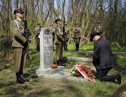 Sean Gallup/Getty Images: Polish President Andrzej Duda kneels at the grave of Pawel Frankiel, a Polish Jewish commander of a Jewish military group during the Second World War called the Jewish Military Union during commemorations of the 75th anniversary of the Warsaw Ghetto Uprising at the Okopowa Jewish Cemetery on April 19, 2018 in Warsaw, Poland. The Warsaw Ghetto was a prison created by the German military during its occupation of Warsaw during the Second World War.