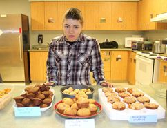 Alyssa Fuchs, 23, a graduate of the Work-Abilities program at Brantwood Community Services, has launched her own baking business. She offered some of her treats at an event on Friday celebrating the program. (Michelle Ruby/The Expositor)