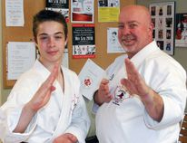 Nicholas Marceau, left, and his father, Chris, of Marceau's Martial Arts and Fighting Systems, are heading to Athens, Greece to compete at the World Kobudo Federation's 18th World Martial Arts Convention May 4-6. They've raised $6,000 so far by picking up donated empty returnable bottles, tin cans and scrap metal over the past year. Dave Dale / The Nugget