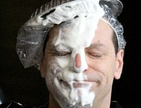 Rob Majic reacts after getting pied at St. Mary's College on April 18.