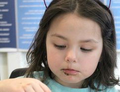 Lydia Blais, 4, decorates a cupcake during We All Love Kids at Sault College on Saturday.