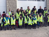 Members of scout troops in Woodstock gather together for a photo before heading out to take part in the Spring Clean-up that cleaned areas of the city. The event had about 100 people participate. Submitted photo