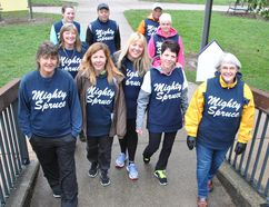 Members of the Mighty Spruce Team make their way along the Hike for Hospice route on a damp and chilly morning in this Beacon Herald file photo. The event returns to Stratford, St. Marys and Mitchell on May 6. Stratford Beacon Herald/Postmedia Network File Photo