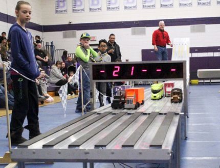 An orange truck cinches a first place finish after rolling down the slanted track at the annual Rapid Races hosted by the Scouts Canada Ken-Kee Council on Saturday, April 21 at the Beaver Brae Secondary School gym. Members of Scout troops in the city put their handmade miniature trucks and cars to the test for a chance to win prizes. KATHLEEN CHARLEBOIS/DAILY MINER AND NEWS