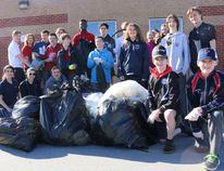 BRUCE BELL/THE INTELLIGENCER Members of the St. Paul Secondary School eco-team show off some of the garbage collected during trash bash on Monday morning. More than 900 students from St. Paul and St. Peter Catholic School spent part of the morning cleaning west-end Trenton.