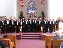 Jack Evans/For The Intelligencer Rev. Brad Beale of St. Thomas Church, at lecturn on right, introduces the Toronto Welsh Male Voice Choir at the start of their concert in the church Sunday afternoon.