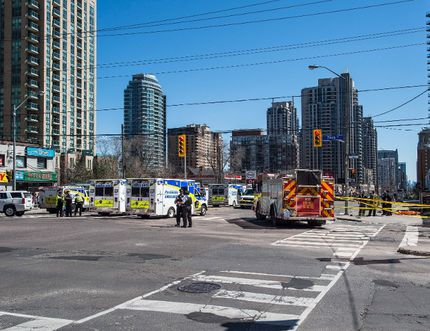 Emergency services close Yonge Street in Toronto after a van mounted a sidewalk crashing into a number of pedestrians on Monday, April 23, 2018. THE CANADIAN PRESS/Aaron Vincent Elkaim