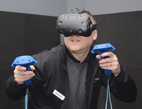 Jonathan Ludlow/ For The Whig-Standard Darren Bishop, owner of The VR Hut Inc., demonstrates how to use the virtual reality systems at The VR Hut in Kingston, Ont. on Wednesday, April 18.