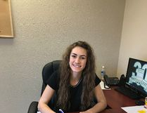 La Crete point guard Heidi Derkson (shown here) signs her letter of intent with the GPRC Wolves. Derkson and her La Crete teammates recently won the 2A provincial championship in girls basketball.