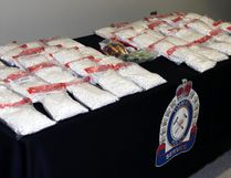 Roughly $385,000 worth of illegal drugs and nearly $50,000 in cash was seized by Timmins Police and Ontario Provincial Police as the result of several search warrants executed in Timmins last week. Three local persons are facing trafficking charges. LEN GILLIS / Postmedia Network