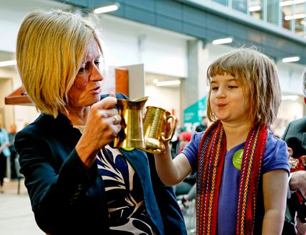 Premier Rachel Notley (left) shares a toast with Morgan Stevens, 3, at Norquest College in Edmonton on Wednesday April 25, 2018. Larry Wong/Postmedia Network