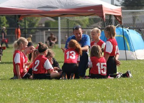Jason Kaspersma, Strathroy United FC's vice president, talks during a game to a group of girls members of the club. Supplied photo.
