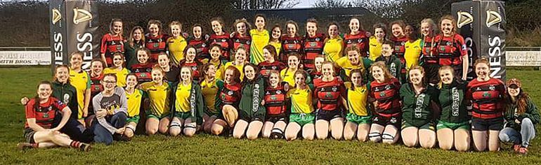 Players from the Holy Trinity Falcons and the Tullamore Rugby Club gather for a group shot.  Handout/Cornwall Standard-Freeholder/Postmedia Network