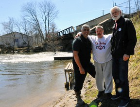John Smith of Thorold joins Dean Wells and Port Dover Coun. John Wells at Misner Dam in Port Dover on Thursday. A request for proposal for repairs to the dam was issued this week with work to begin as early as July. JACOB ROBINSON/Simcoe Reformer