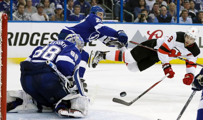 Tampa Bay Lightning defenceman Ryan McDonagh (27) sends New Jersey Devils left-winger Taylor Hall (9) flying after Hall shot against goaltender Andrei Vasilevskiy (88) during the third period of Game 5 of an their first-round NHL  playoff series last weekend in Tampa, Fla. (AP Photo/Chris O'Meara)