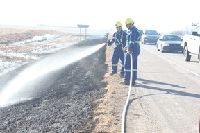 Members of the Melfort Fire Department extinguished hot spots at a grass fire west of Melfort on Thursday, April 26.