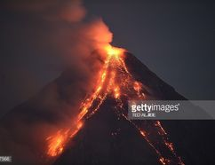 Mayon volcano emits lava cascading the slope as seen from Legazpi City, in Albay province, south of Manila on January 30, 2018. The threat of catastrophic mudflows is building on the slopes of an erupting Philippine volcano where nearly 90,000 residents have been moved out of harm's way, authorities said Tuesday. / AFP PHOTO / TED ALJIBE (Photo credit should read TED ALJIBE/AFP/Getty Images)
