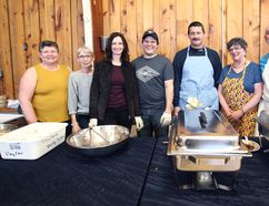 From left to right : Janet Boot, Janice Andrews, Kerry Townsend, Scott Townsend, Kirk Berard, Debbie Chartrand and Tuckersmith Coun. Ray Chartrand on hand volunteering their time dishing out the meals for the fourth annual chicken dinner at the Vanastra Recreation CentreApril 20. (Shaun Gregory/Huron Expositor)