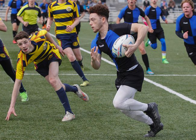 Kingston Blue Raiders' Isaiah McCloud runs and gets a try against the Napanee Golden Hawks during the first half of the Kingston Area Secondary Schools Athletic Associations senior boys rugby game at the Nixon Field, in Kingston, Ont., on Friday, April 27, 2018. The Golden Hawks won 36-5. Julia McKay/The Whig-Standard/Postmedia Network