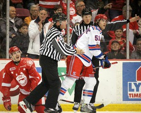 Soo Greyhounds Taylor Raddysh squawks as Kitchener Rangers Michael Vukojevic heads to the penalty box during the first period of Game 5 of the Ontario Hockey League Western Conference championship series at Essar Centre on Friday.