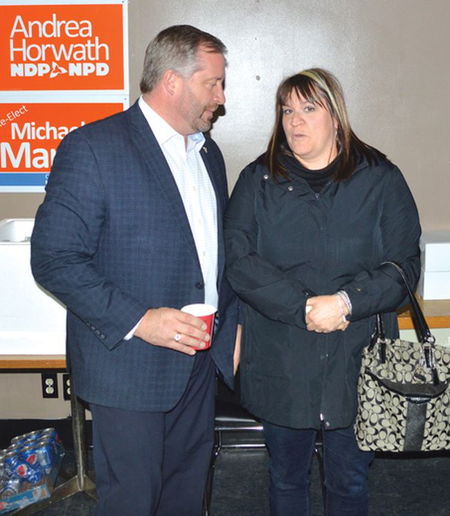 Photo by KEVIN McSHEFFREY/THE STANDARD Algoma-Manitoulin incumbent MPP Michael Mantha, who is also the NDP's candidate for this riding, speaks to Natalie Timeriski at the official opening of Mantha's campaign office opening in Elliot Lake.