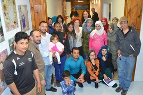 The Making Grey Bruce Home community space opened at 228 8th St. E. on Saturday, April 28, 2018 in Owen Sound, Ont. The space is to provide information on living in Grey-Bruce to refugees and others. Newcomer Advocate Mokless Hassan, kneeling in front at left, and project co-ordinator May Ip, kneeling at front in the middle, gather at the opening with some of those who may use the service. Rob Gowan/The Owen Sound Sun Times/Postmedia Network