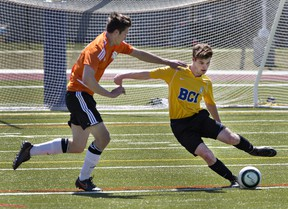 Ethan Andrew of North Park Collegiate moves in on Carter McAuley of Brantford Collegiate Institute during a high school boys soccer match on Monday at Bisons Alumni North Park Sports Complex. (Brian Thompson/The Expositor)