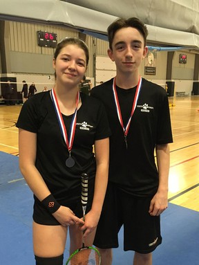 Pictured are Keeley Mitchell (left) and Braeden McNaughton (right) standing with their medals and rackets after their golden performance at WOSSA on April 11.