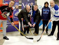 United Way Centraide North East Ontario executive director Michael Cullen, centre left, and Timmins Mayor Steve Black prepare to drop the puck between Rouyn-Noranda Huskies coach and general manager Gilles Bouchard and Sudbury Wolves vice president of hockey operations and general manager Rob Papineau during a press conference at the McIntyre Arena Tuesday morning. The press conference was to announce an exhibition contest between the two clubs at the McIntyre Arena on Friday, Sept. 14, to raise funds for the United Way and Bell Let's Talk program. THOMAS PERRY/THE DAILY PRESS