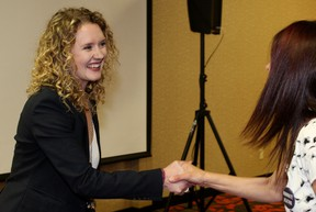 Laila Goodridge shakes hands with party members at the Quality Hotel and Conference Centre on Tuesday, May 1, 2018, shortly after being elected as the United Conservative Party's candidate in the Fort McMurray-Conklin byelection. Vincent McDermott/Fort McMurray Today/Postmedia Network