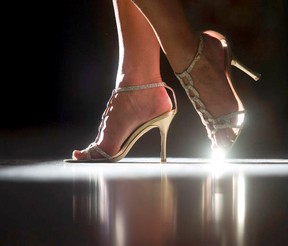 A 12 graduate wears a sparkling pair of shoes as she enters the prom night party for her high school. Ted Rhodes / Postmedia