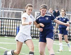 Silvanna Vitello of the Marymount Academy battles for the ball with Katryna McLeod of College Notre Dame during senior girls high school soccer action in Sudbury, Ont. on Thursday May 3, 2018. Gino Donato/Sudbury Star/Postmedia Network