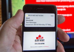 A smartphone and a television receive visual and audio alerts to test Alert Ready, a national public alert system Monday, in Montreal.THE CANADIAN PRESS/Ryan Remiorz