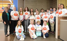 Students hold their certificates for Ronald's Readers at the Walmart McDonalds in Whitecourt on May 3 (Peter Shokeir | Whitecourt Star).