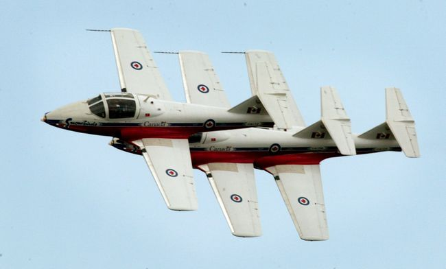 A trio of Snowbirds, the Canadian built CL-41 Tutor jet aircraft, perform. On May 3, 1978, Captain Gordon de Jong's Tutor crashed at an airshow in Grande Prairie.