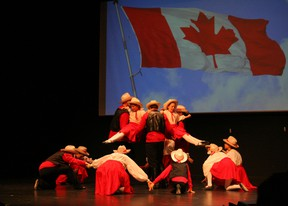"""One of the final numbers in Glorious and Free was """"Canadian Hoedown"""" with the image of the Canadian Flag flying in the background and all performers dressed in red and white."""