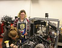 Amber La Brecque (Ecole Heritage) and Lee Guerette (Ecole Quatre Vents) work at testing compression on a v-8 engine in the GPRC Fairview College Campus Automotive Technology shop during the Trades and Technology Camp held at the college May 3-4.