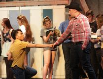 KEVIN RUSHWORTH HIGH RIVER TIMES/POSTMEDIA NETWORK. Ren McCormack, portrayed by Wilmar Rasos, meets Willard Hewitt, played by Cole Simms, in Highwood High School's production of the musical version of Footloose. The curtain opened on the show May 3 and dates continued on May 4 and 5.