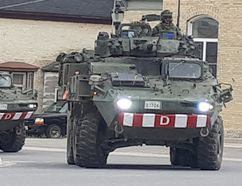 About a dozen Canadian Forces armoured vehicles rolled through Tiverton Sunday afternoon, May 6, 2018 to smiles and waves from onlookers. The soldiers atop the military vehicles waved back as they rounded the corner and continued up Highway 21. (Troy Patterson/Kincardine News and Lucknow Sentinel)