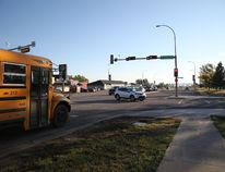 A school bus sits at the light on the corner of Silin Forest Road and Thickwood Blvd. as McMurray's students head back to classes on the first day of a new school year in 2016.
