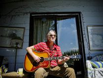 Postmedia File Photo Canadian singer-songwriter and musician Greg Keelor poses for a portrait while playing the guitar at his country home near Kendal, Ontario.