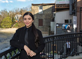 Actress Ana Golja takes a break between scenes on the set of The Cuban, which has been filming in Brantford and Brant County for the past several weeks. Shooting took place at 2 Rivers Restaurant in downtown Paris on Thursday. (Brian Thompson/The Expositor)