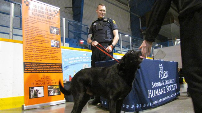 Paul Morden/Sarnia Observer/Postmedia Network Ryan Sparks, an agent with the Sarnia and District Humane Society, and Milo greeted visitors Friday at an Emergency Preparedness Day held at the Clearwater Arena. More than 100 exhibitors took part in this year's event.