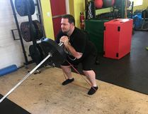 Jan Murphy performs a landmine goblet squat with band for accommodating resistance and anti-foot arch collapse during his training at 247 Fitness with Visionary Fitness owner Farr Ramsahoye. (Farr Ramsahoye/Visionary Fitness)