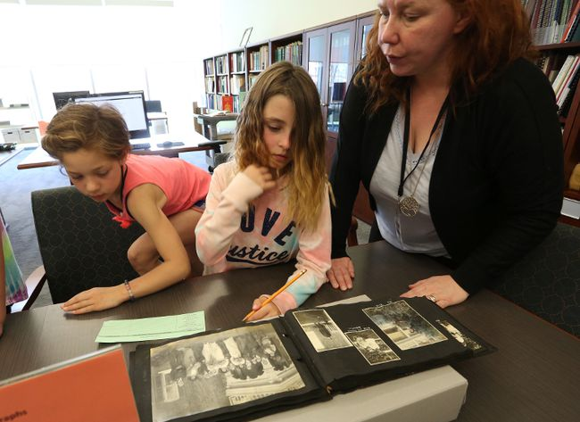 Curator JoAnne Himmelman talks to some Grade 3 Southview PS students about historic photos at the Lennox and Addington Museum and Archives on May 9, 2018. Meghan Balogh/The Whig-Standard