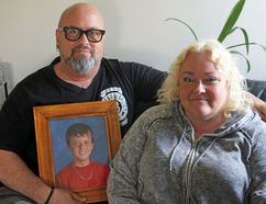 Dave and Gwen Mills at their home in Napanee, Ont. on Thursday May 10, 2018 with a photo of their late son Garrett. Steph Crosier/The Whig-Standard/Postmedia Network